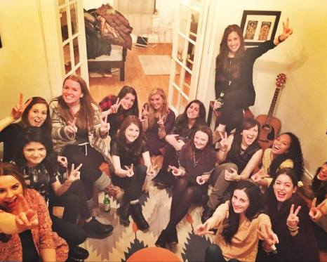 One filipino american journalist sitting on the floor of a group of white women, illustrating why representation in the media is lacking terribly.