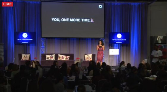 A filipina american woman giving a lecture at the GirlUp Youth Summit in Washington, DC.